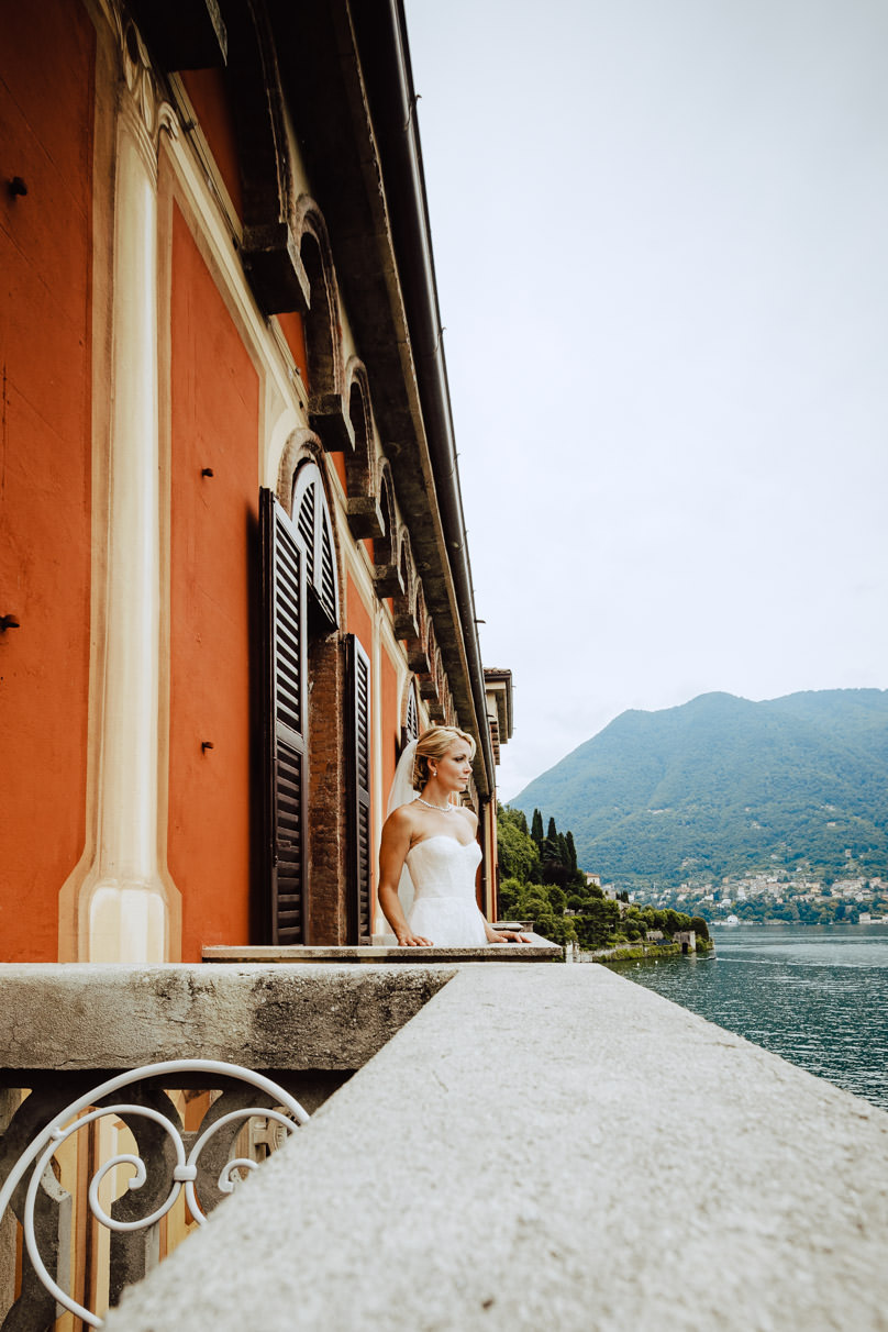 bride admiring view from her room lake como