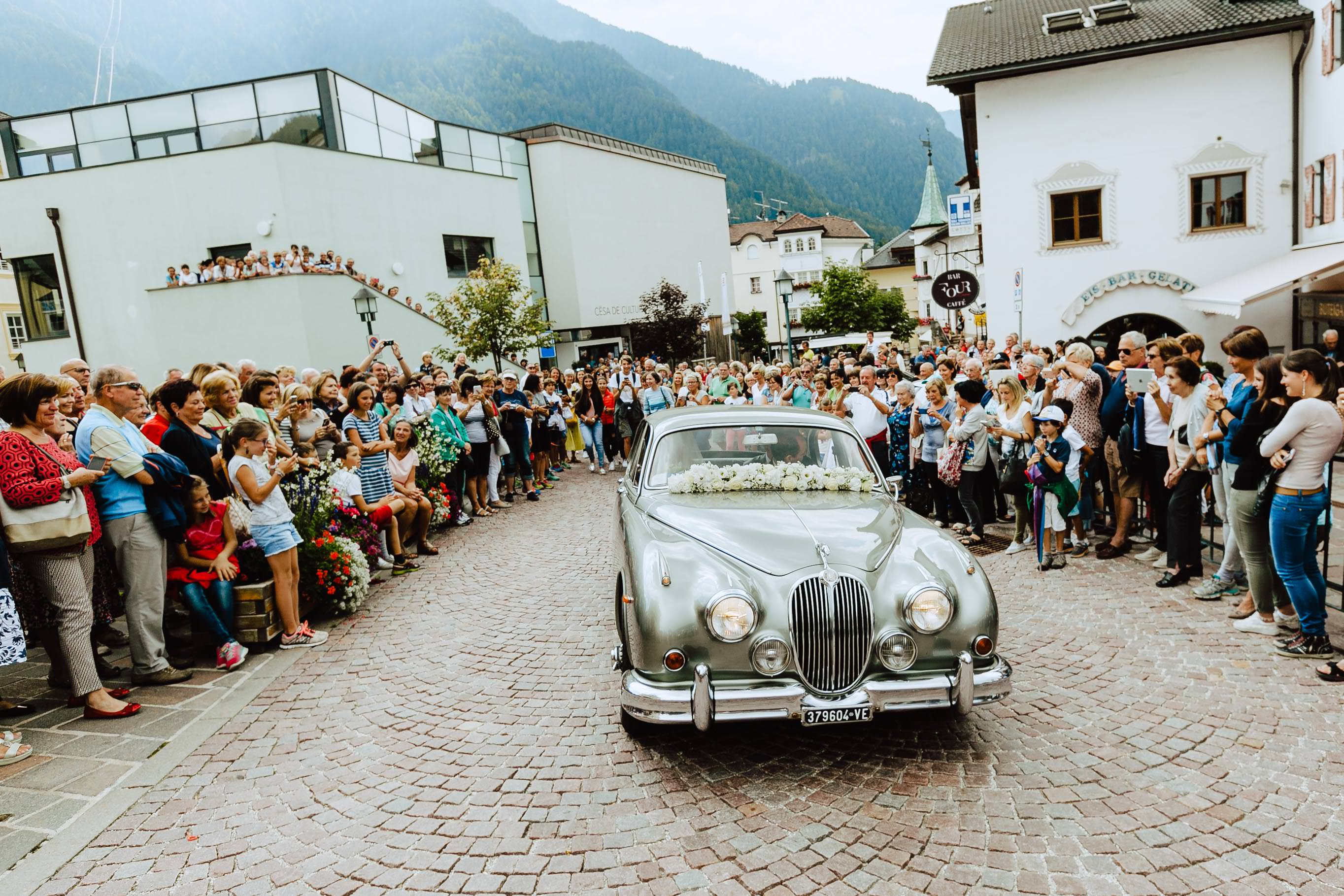 bride arriving to church ortisei wedding