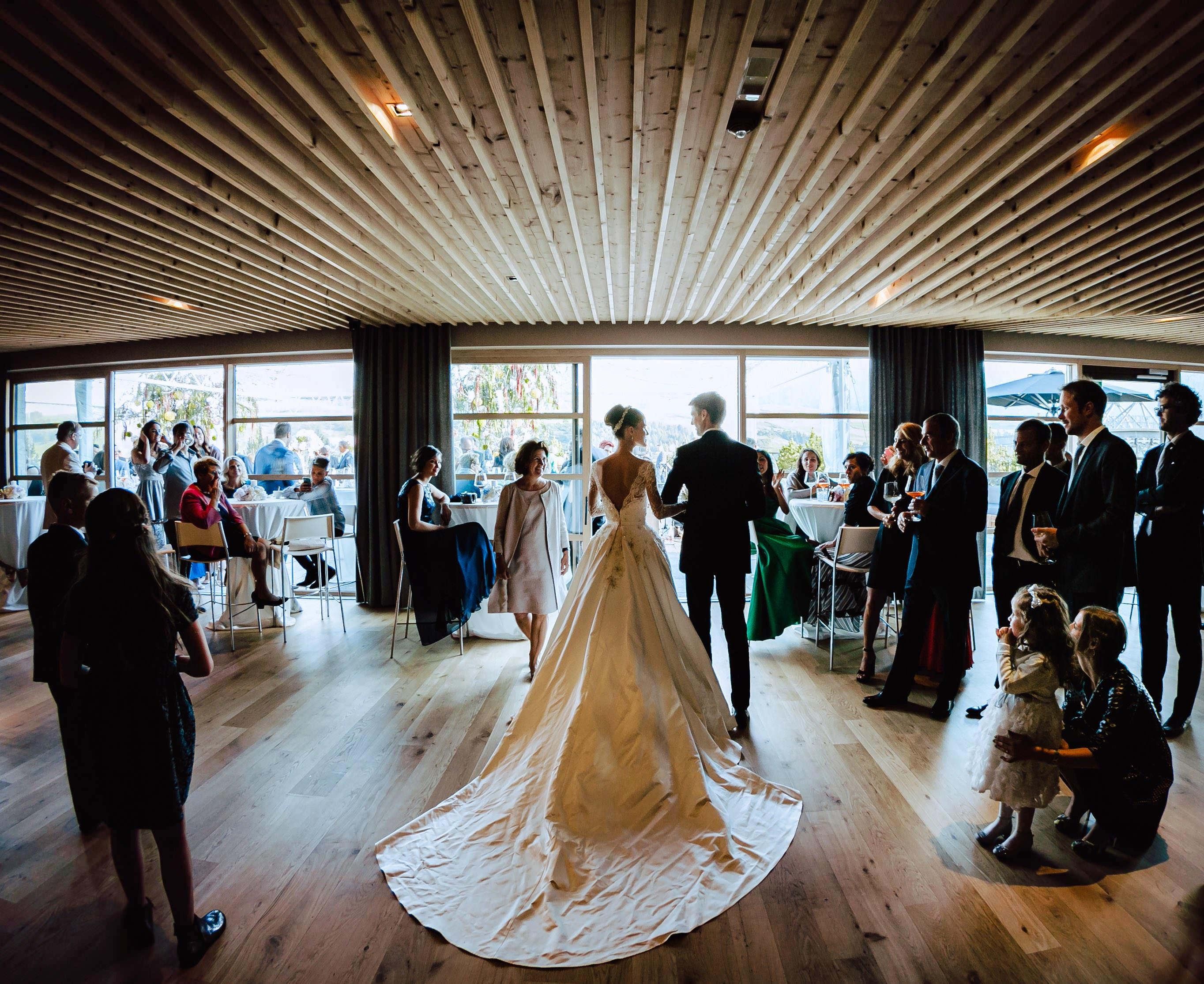 bride groom entering main hall alpina dolomites hotel