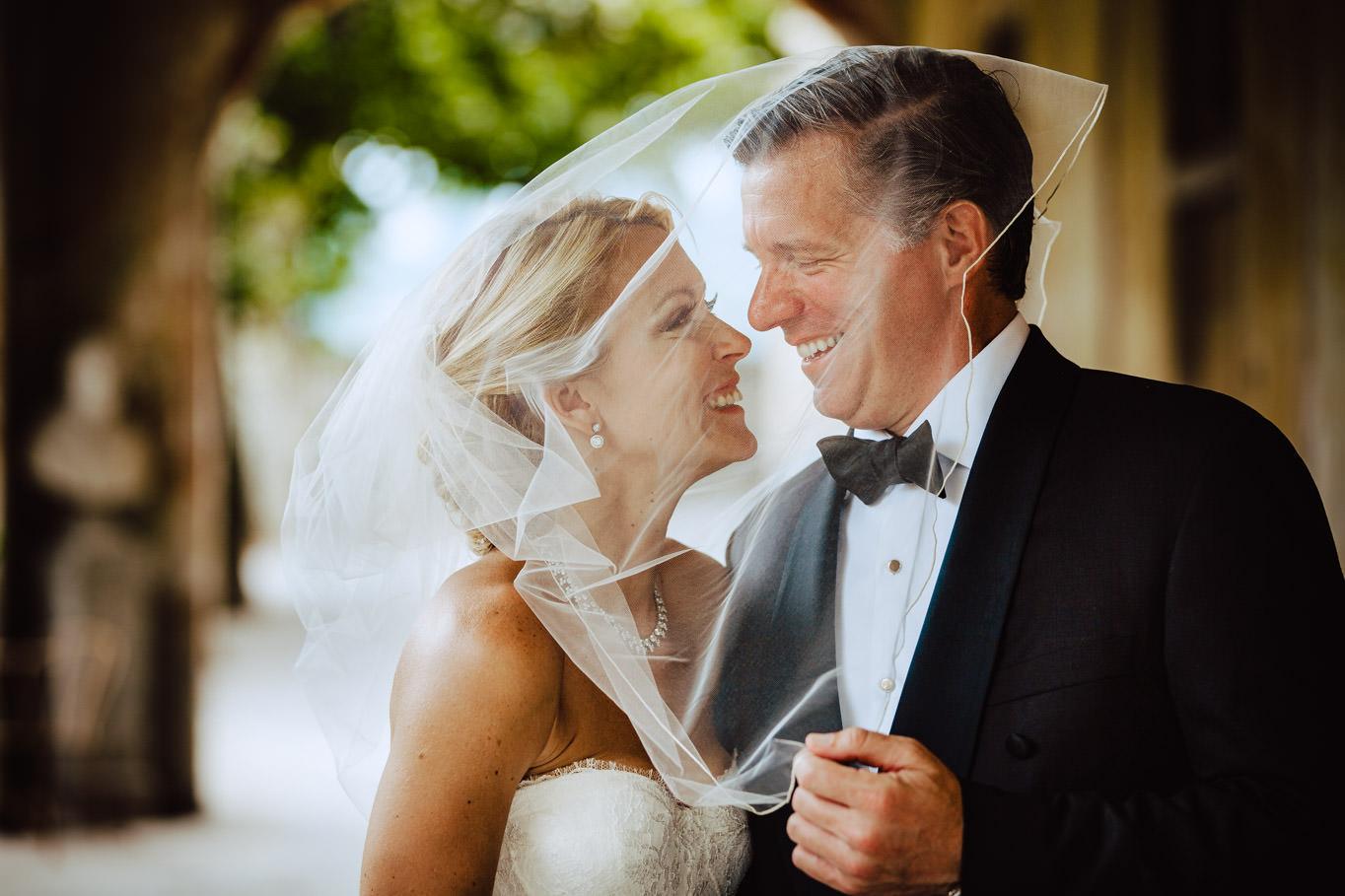 bride groom under veil lake como wedding