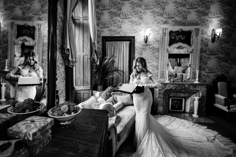 bride opens present wedding day