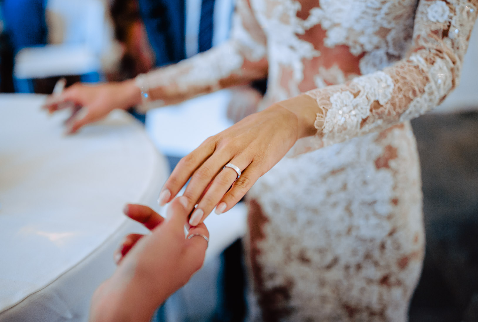 bride showing ring to a guest wedding
