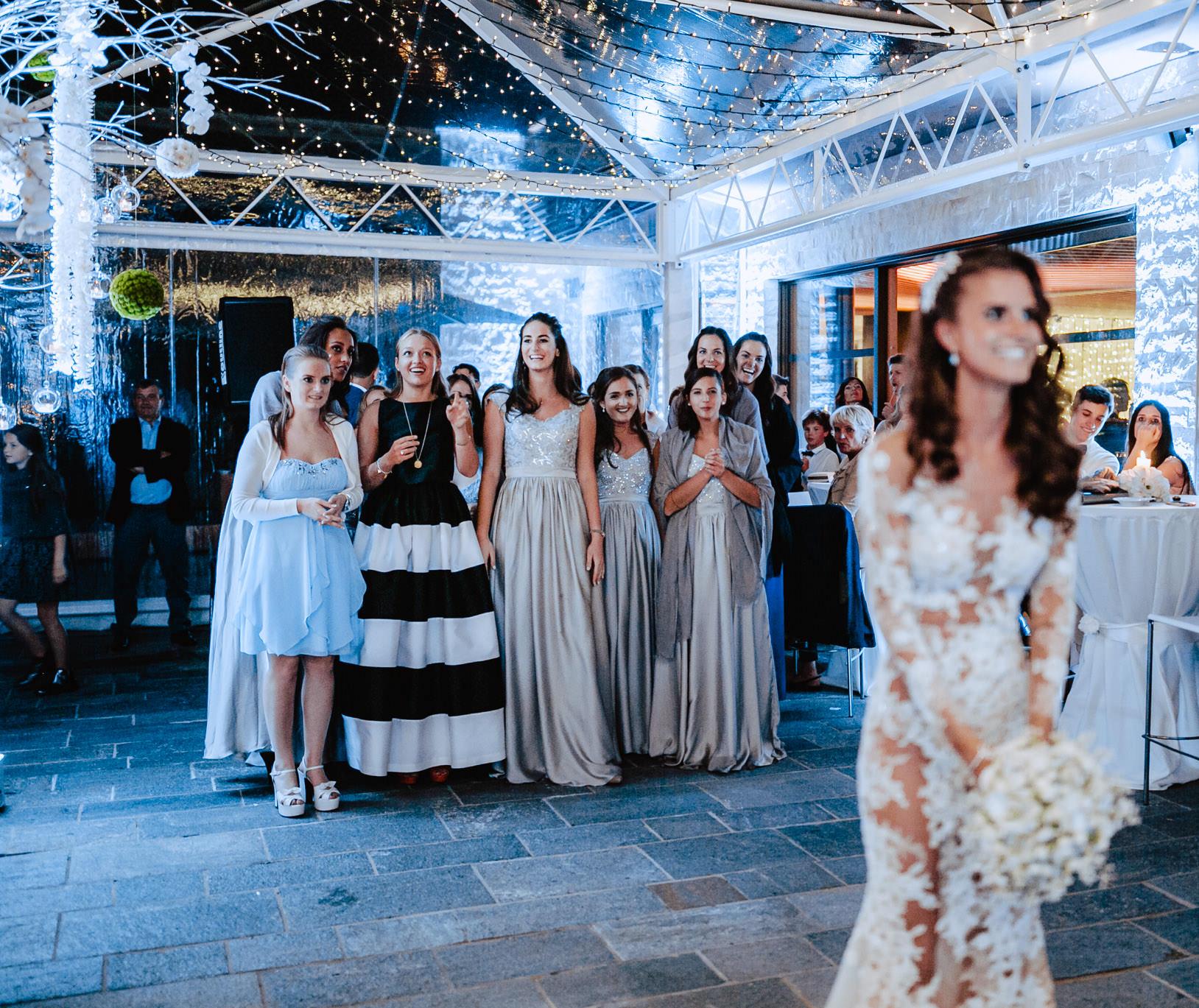 bride throws bouquet wedding alpina dolomites hotel