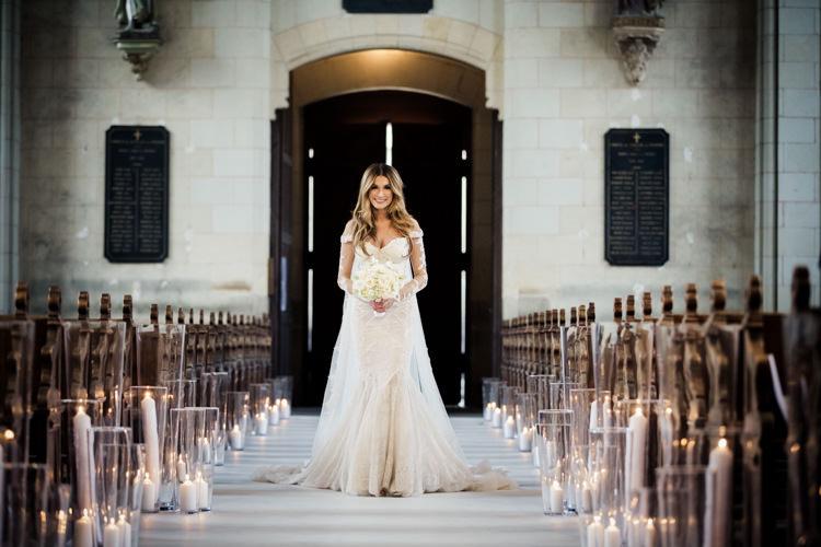 bride walking isle church chateau challain