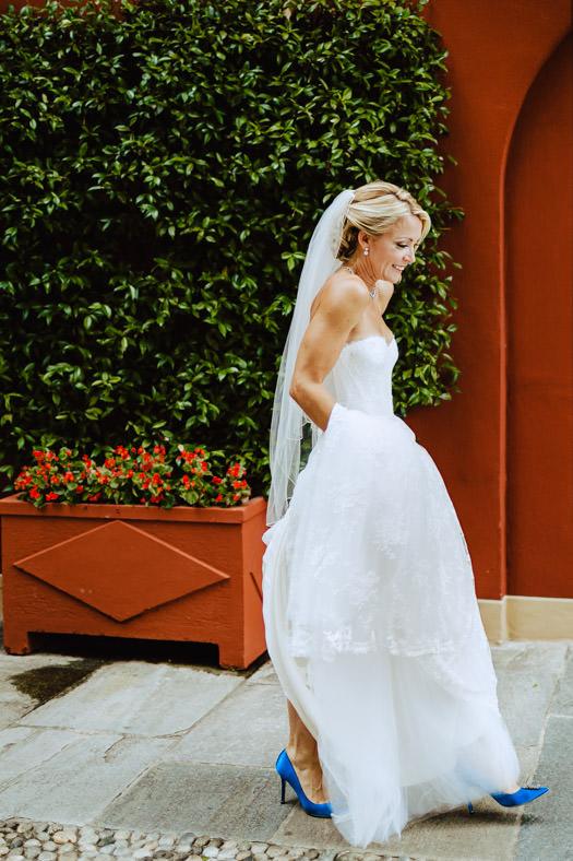 bride walking towards first look lake como