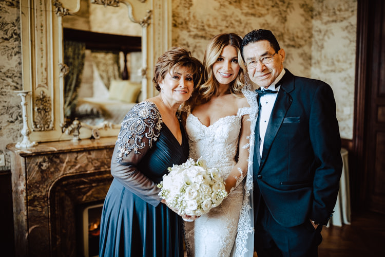 bride with parents chateau challain wedding