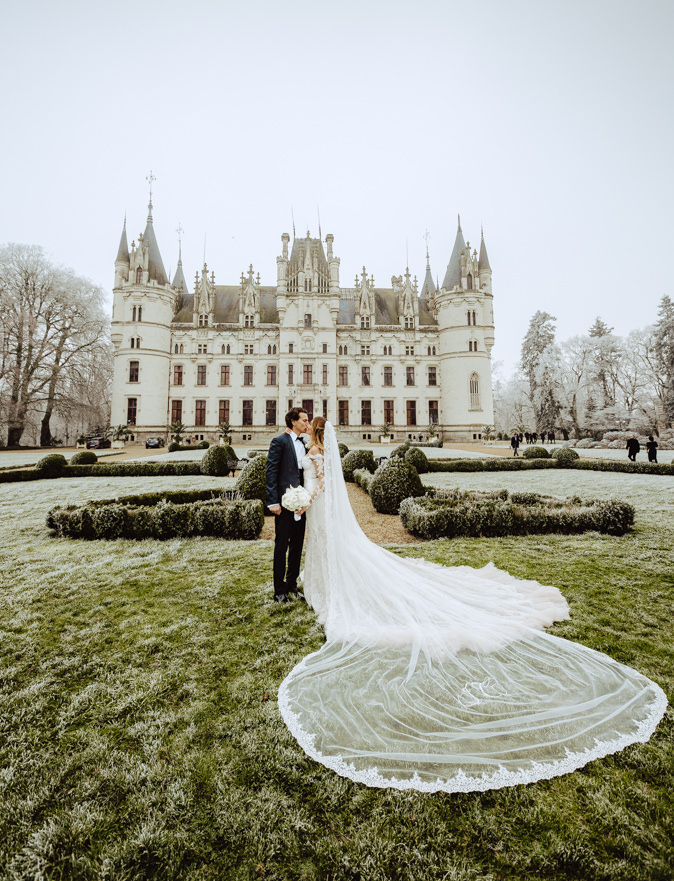 couple front chateau challain winter wedding
