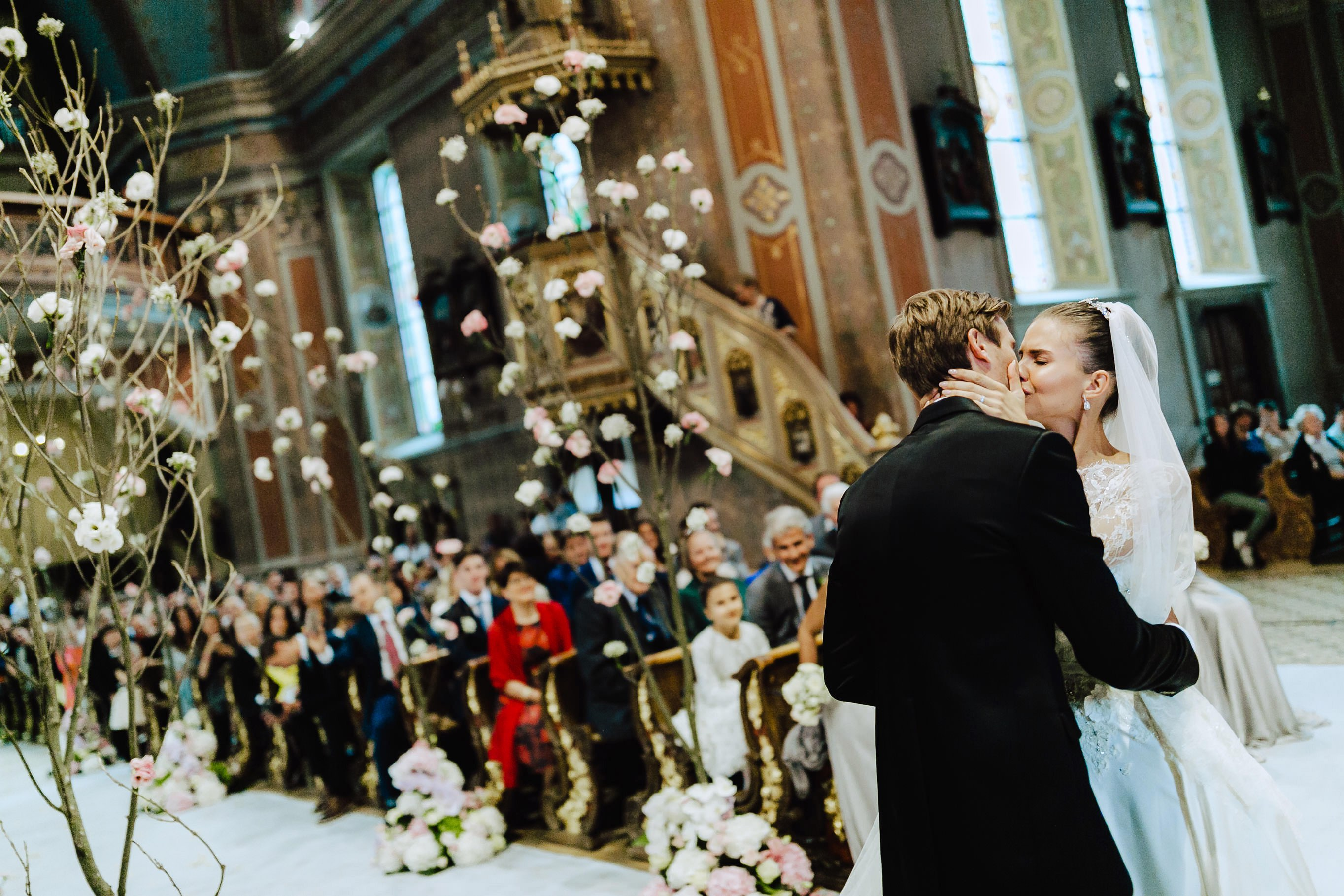couple kissing after exchange of faith