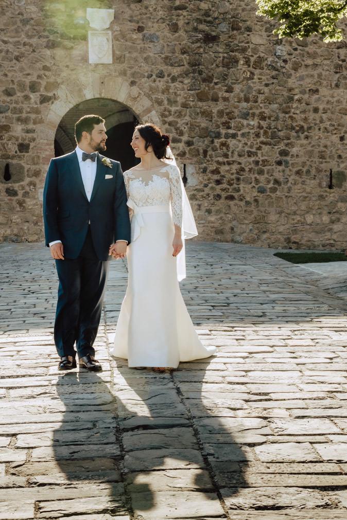 couple walking castello di montalcino wedding