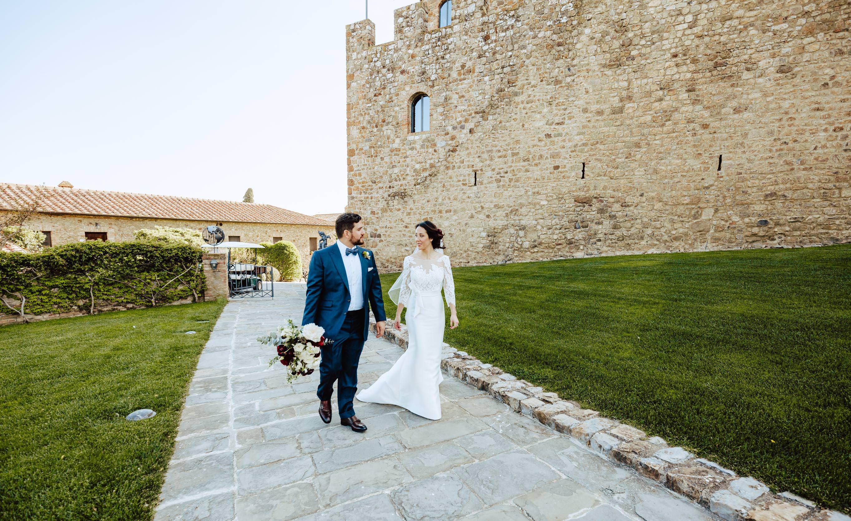 couple walking wedding castello di montalcino