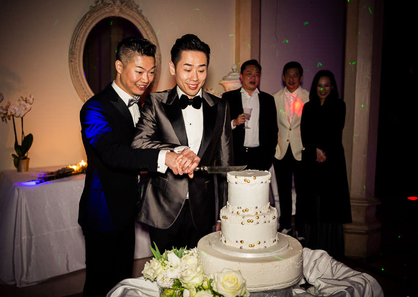 cutting of the cake same sex wedding