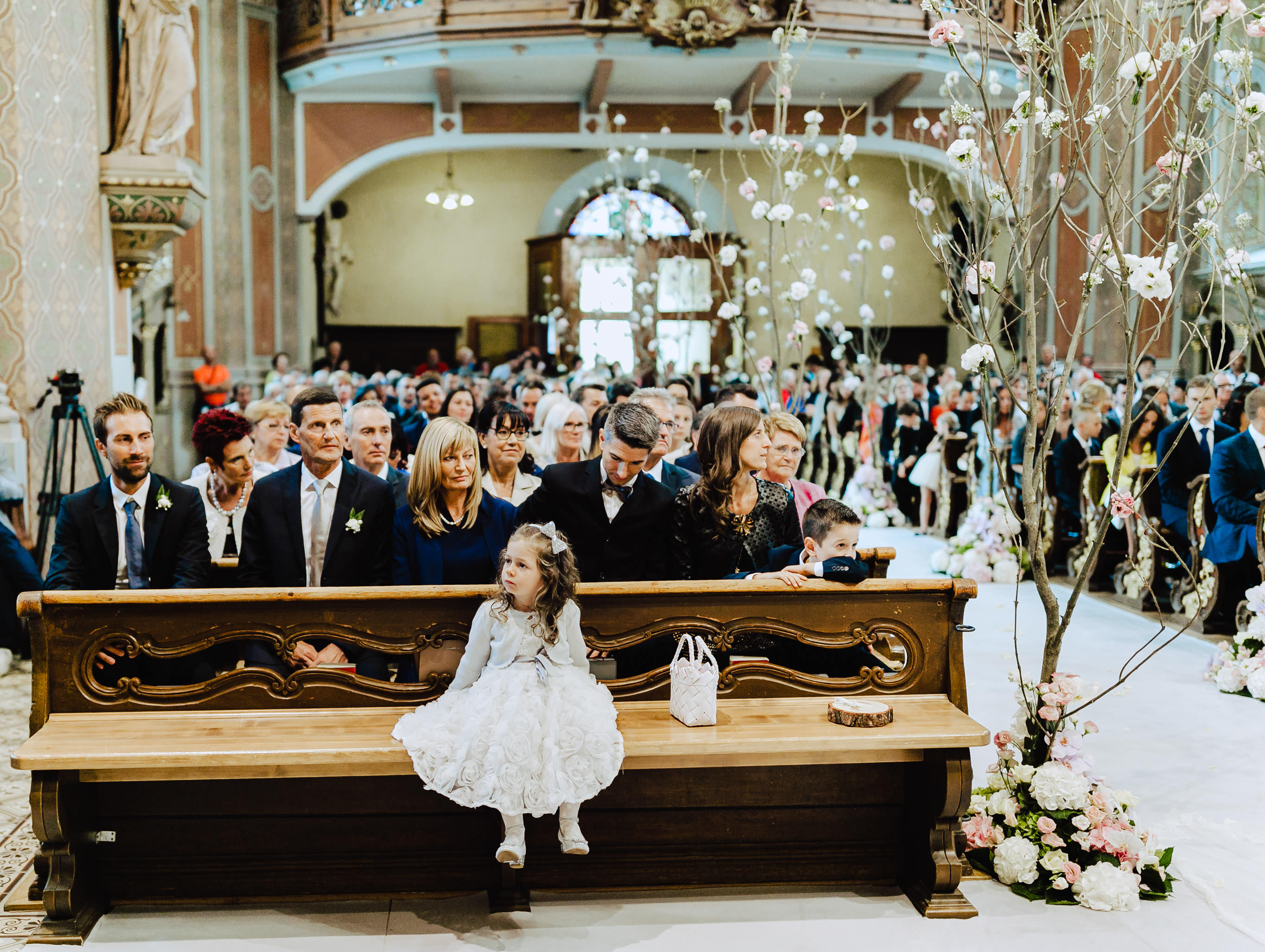 flower girl at ceremony church ortisei italy