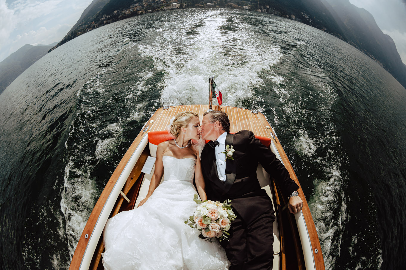 newlyweds boating on lake como