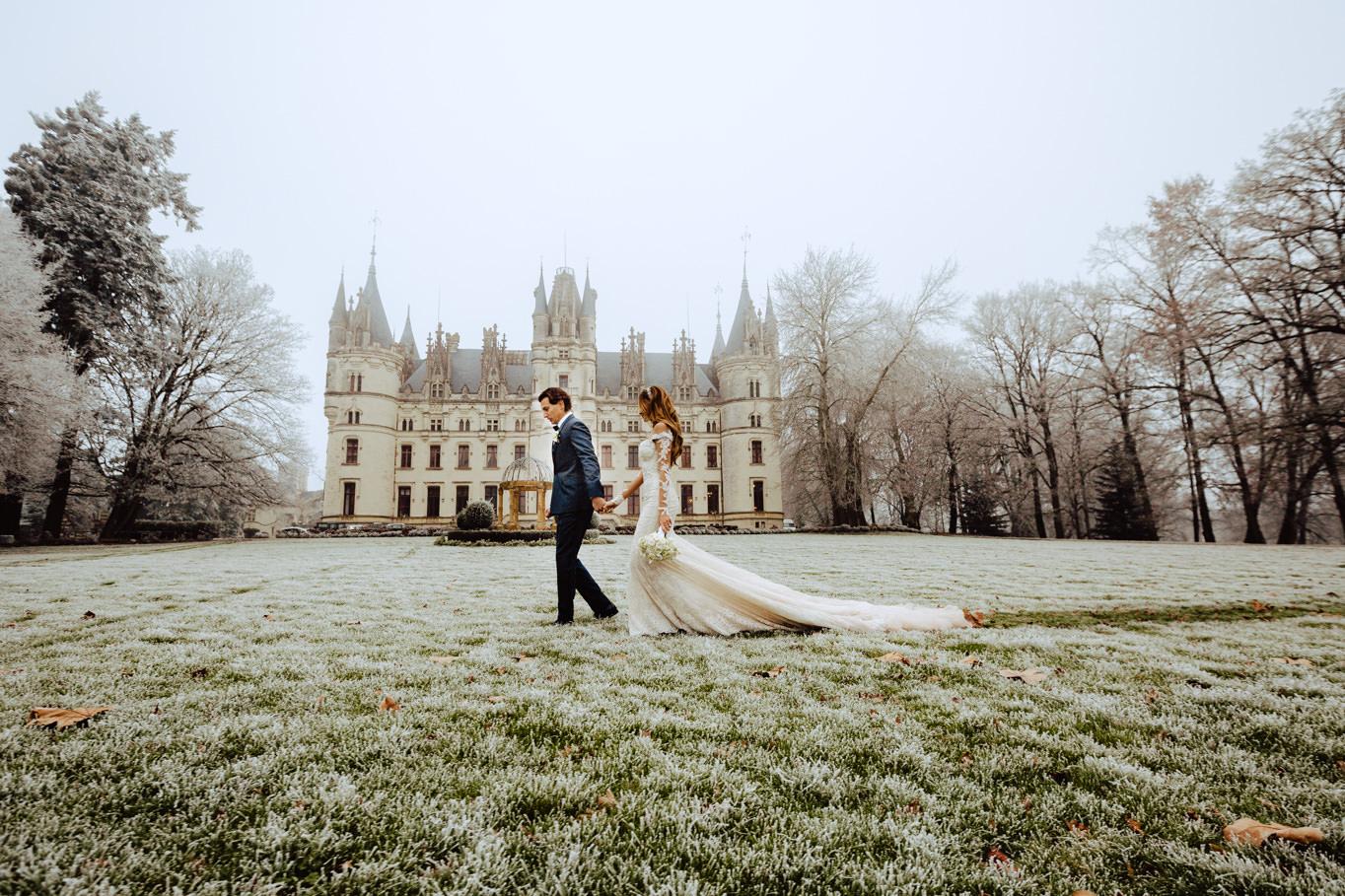 wedding couple walking frozen lawn