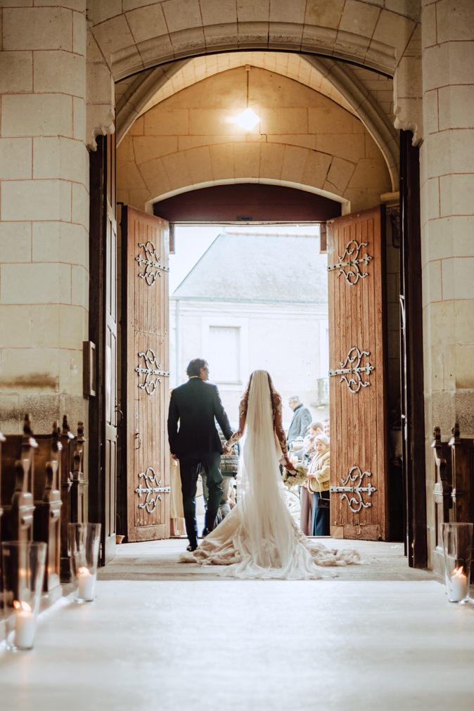 wedding couple walking out church