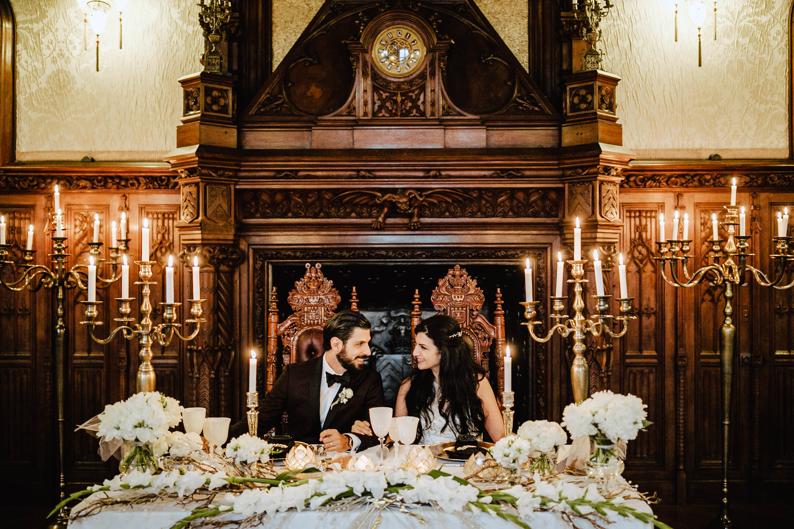 bride and groom at wedding table chateau challain candles