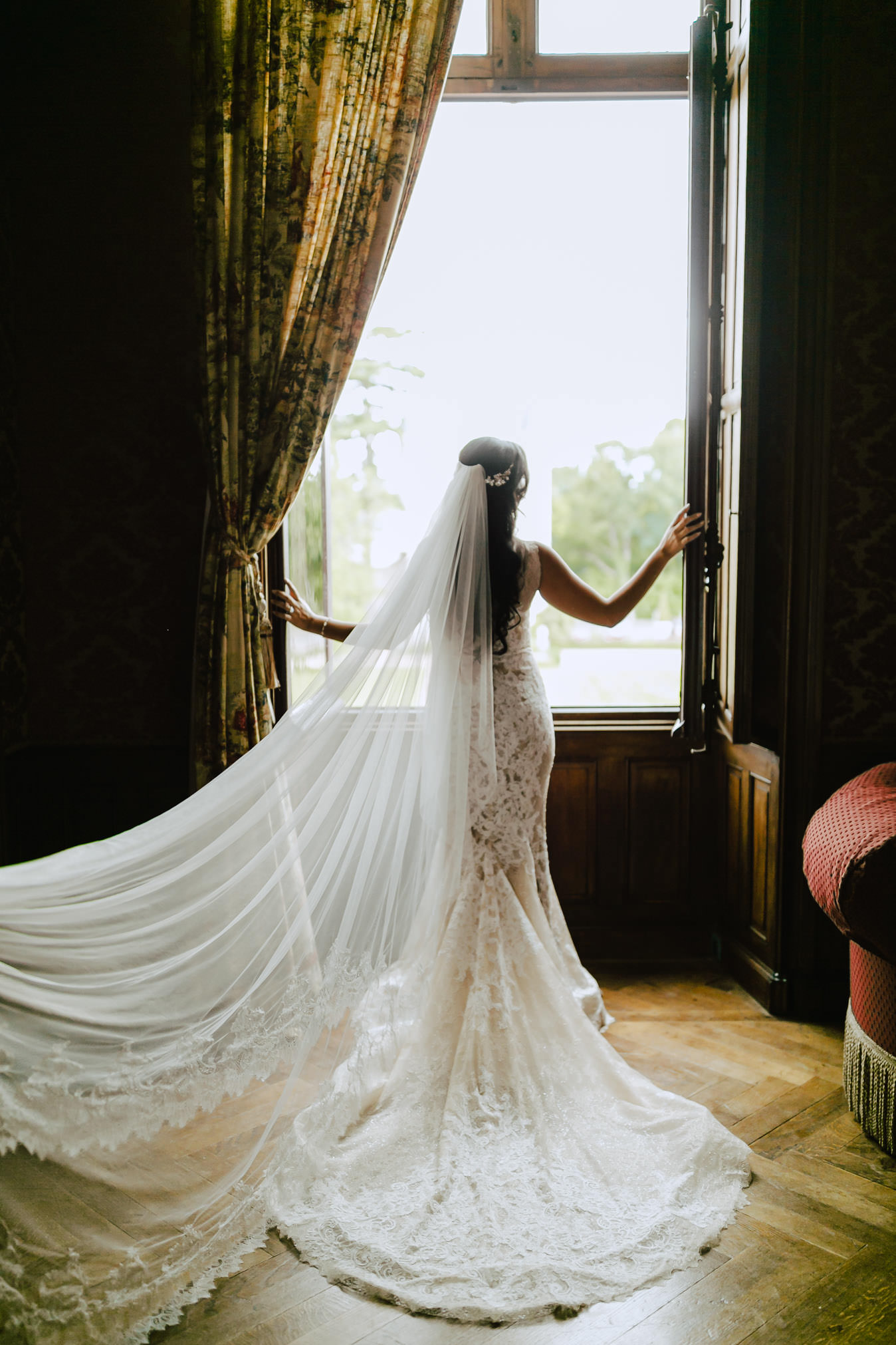 bride at the window with her galia lahav dress
