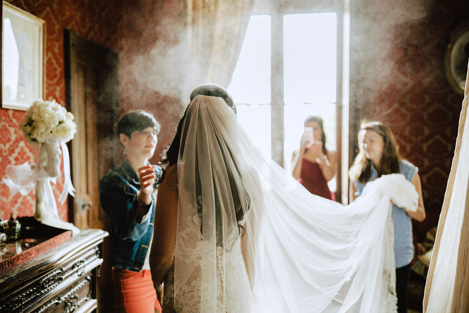 bride in a cloud of hairspray chateau challain