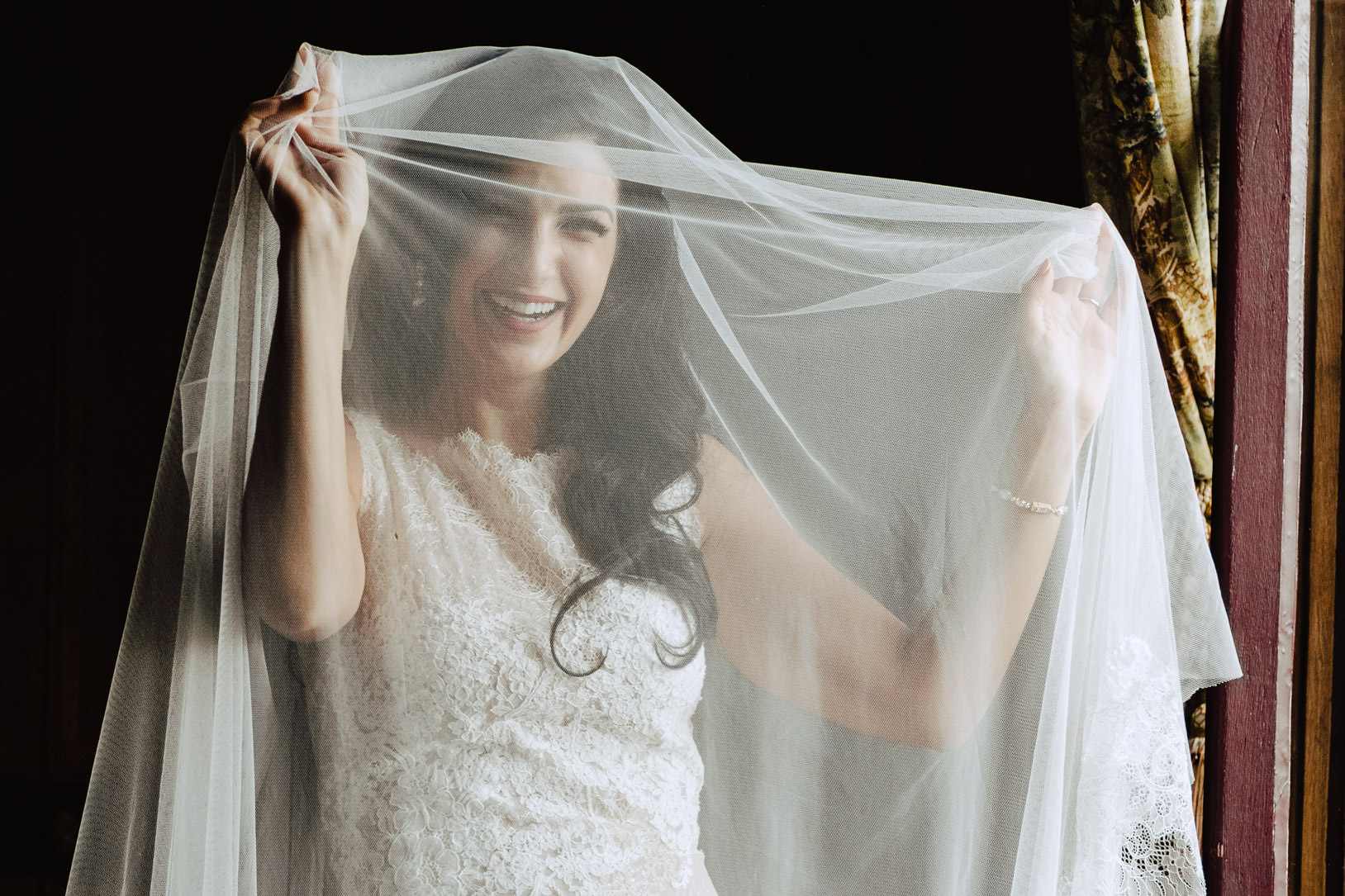 bride laughing under her veil chateau challain wedding