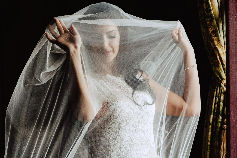 bride under her veil chateau challain wedding