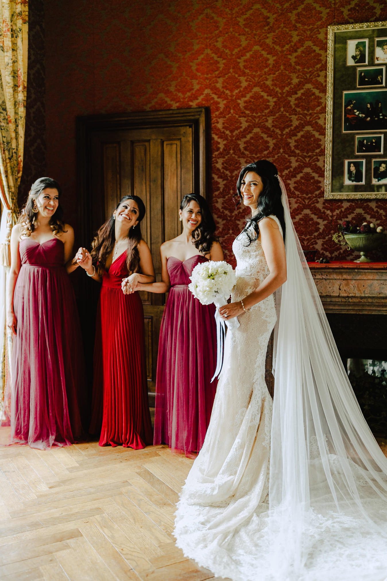 bride with her bridesmaids chateau challain wedding