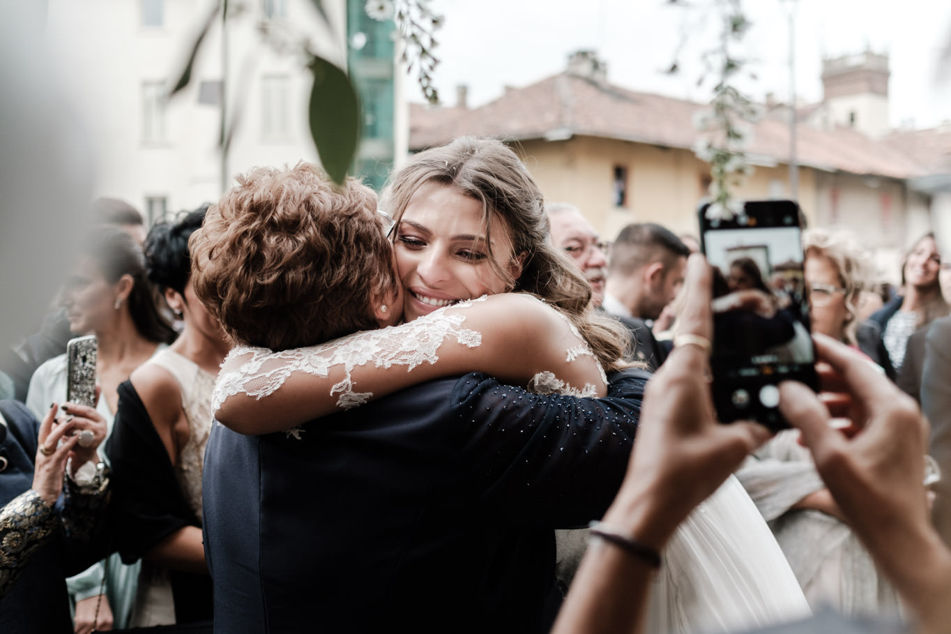 cristina chiabotto wedding hugs with guest